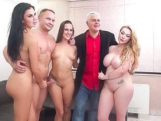 Three kinky babes chow down on one amateur's heafty cock !